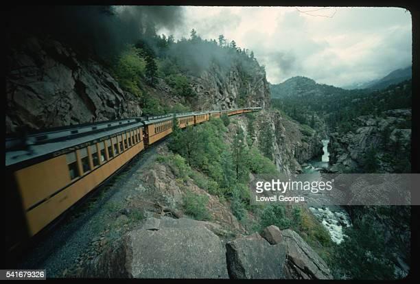 rail line follows river gorge - san juan mountains stock photos and pictures