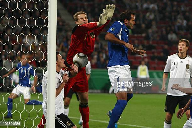 Rail Malikov of Azerbaijan scores his team's first goal against goalkeeper Manuel Neuer and Sascha Riether of Germany during the EURO 2012 Group A...