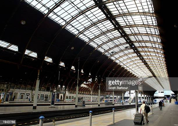A rail passenger leaves an empty Paddington Station April 22 2003 in London England Commuters returning to work after the Easter break found that the...