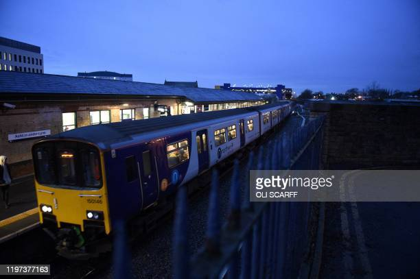 Rail passengers commute on a Northern train operated by Arriva a unit of Germany's Deutsche Bahn as it passes through the train station in...