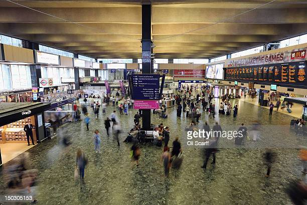 Rail passengers in Euston Station a terminus of the West Coast Mainline route on August 15 2012 in London England Virgin Rail has been outbid by...