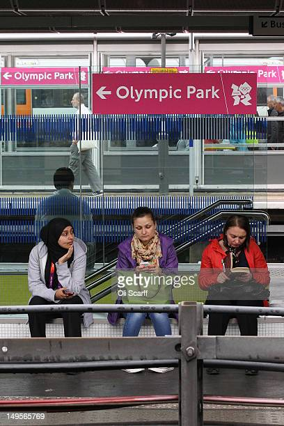 Rail passengers wait for a train in Stratford Station adjacent to the Olympic Park on July 31 2012 in London England The Central Line a major London...