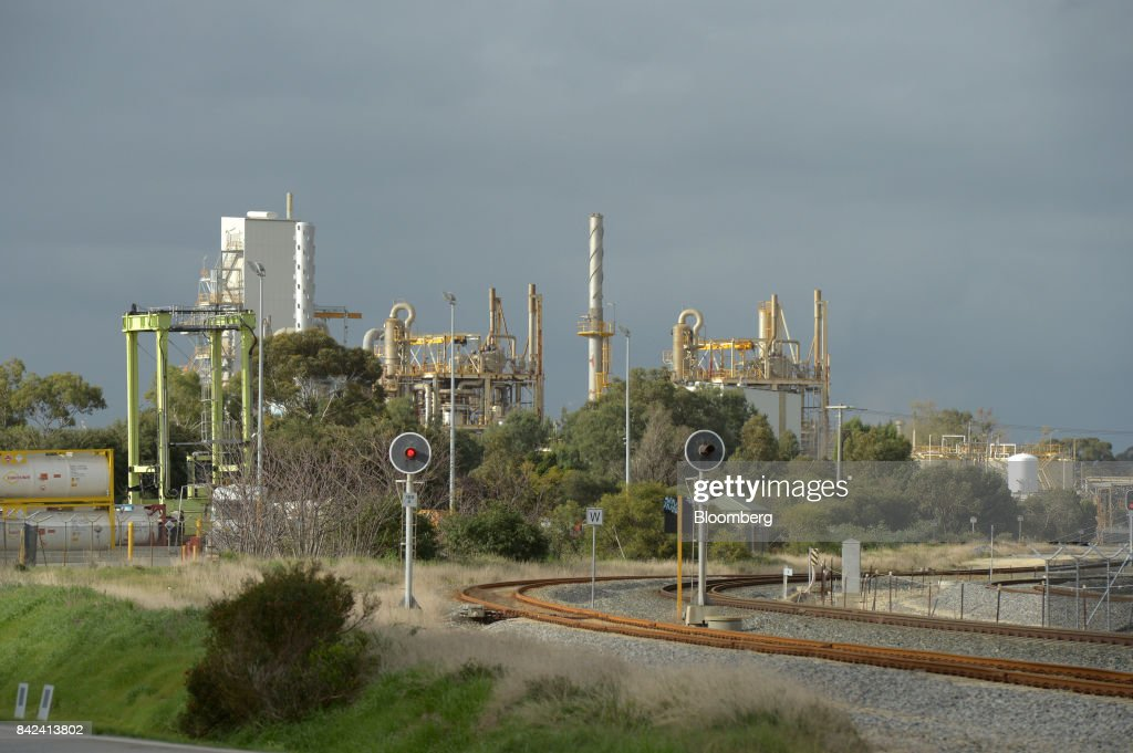 Rail tracks run through the industrial port area of Kwinana