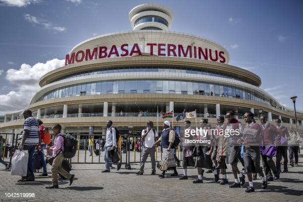 Rail travelers pass the entrance to Mombasa SGR Terminus station in Mombasa Kenya on Saturday Sept 1 2018 China's modernday adaptation of the Silk...