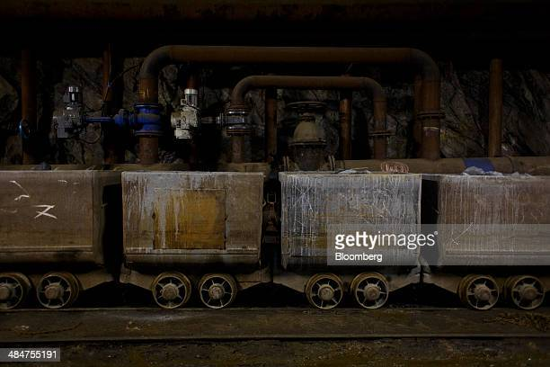 Rail trucks loaded with rocks containing uranium ore wait for transportation in the Rozna mine operated by Geam a division of Diamo SP mining company...