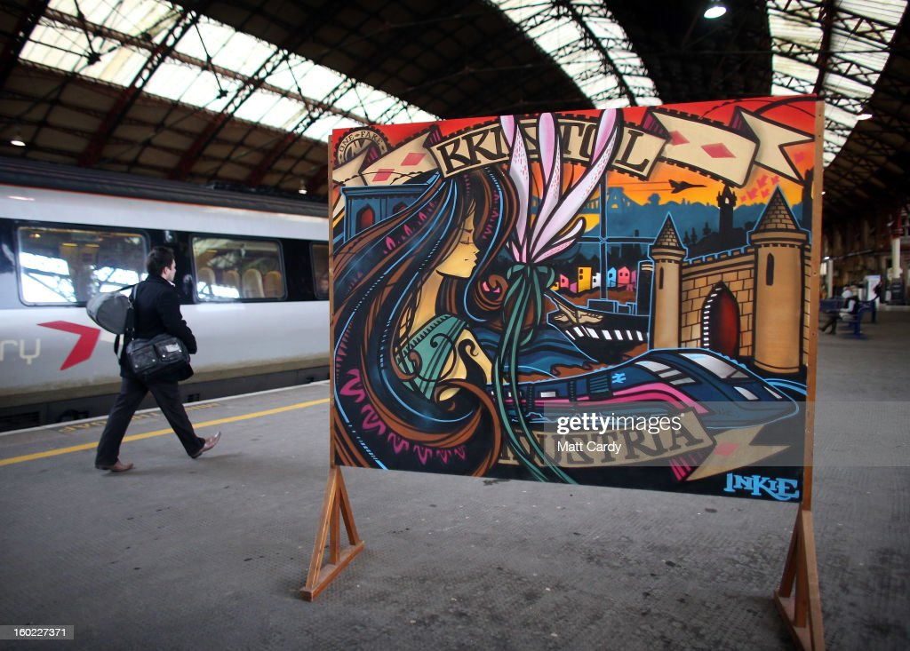 Rail users walk past a piece of graffiti art by Bristol born artist Inkie, which was unveiled to launch a brand new creative commissioning project for the Bristol Temple Quarter Enterprise Zone, on January 28, 2013 in Bristol, England. The work, titled 'Bristol to Brooklyn', will be on display at Bristol's Temple Meads train station and will welcome visitors to the city as they arrive in the spiritual home of the UK graffiti scene and internationally renowned artist Banksy.