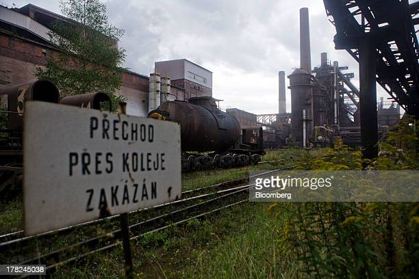 Rail wagon's stand on train tracks at ArcelorMittal's steel plant in Ostrava, Czech Republic, on Monday, Aug. 26, 2013. ArcelorMittal, the world's...