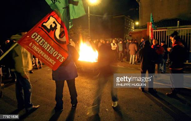 Rail workers gather and block the entrance of SNCF's workshops in Hellemmes near Lille northern France 15 November 2007 on the second day of the...
