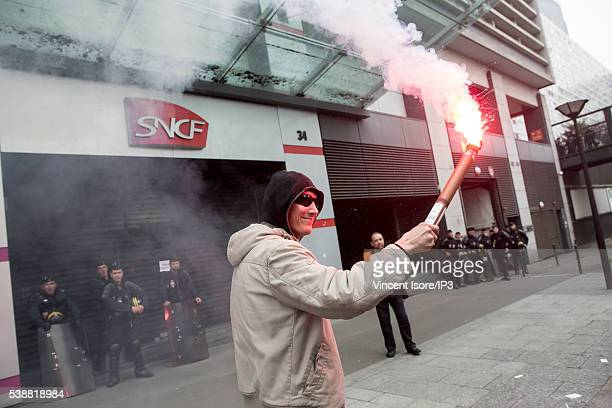 Rail workers who demonstrate against the new Labour Law known as the 'ElKhomri Law' stand in front of the parisian former SNCF Group headquarters on...