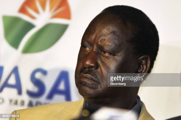 Raila Odinga opposition leader and presidential candidate for the National Super Alliance looks on as a journalist asks a question during a news...