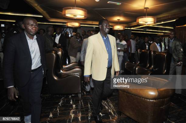 Raila Odinga opposition leader and presidential candidate for the National Super Alliance center exits after attending a news conference at the...