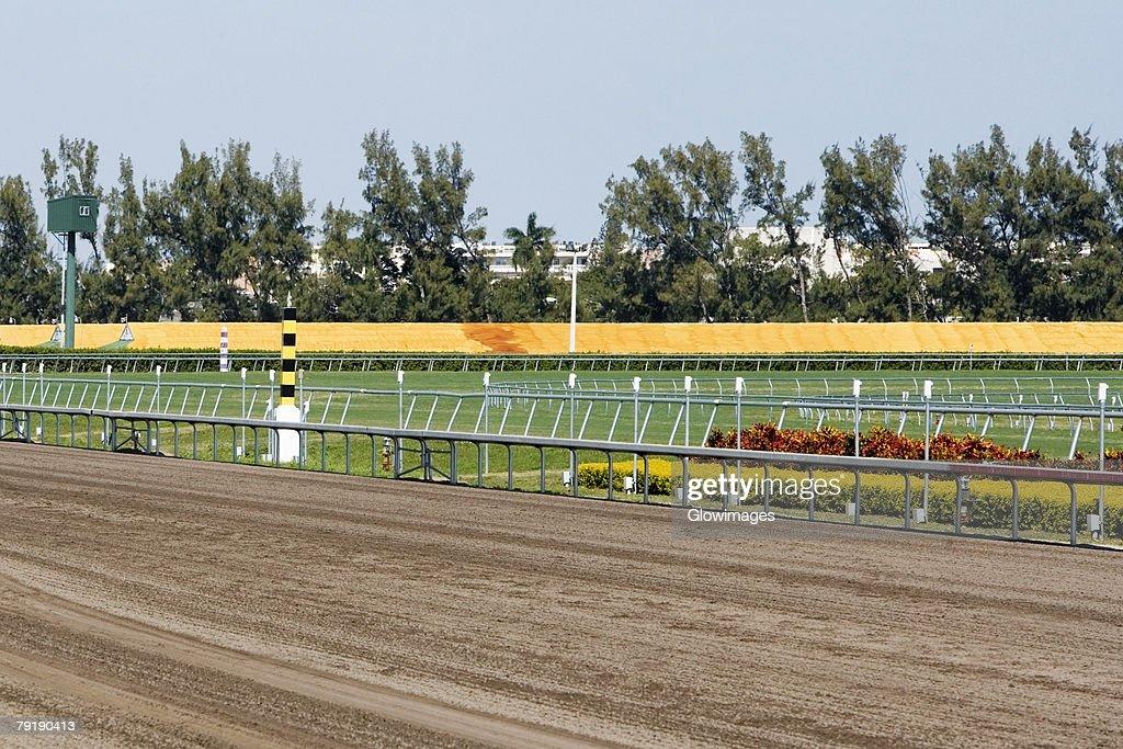 Railing along a horseracing track : Foto de stock