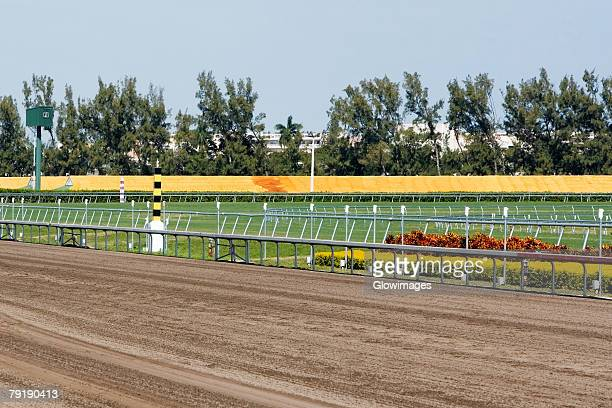 railing along a horseracing track - horse racecourse stock photos and pictures