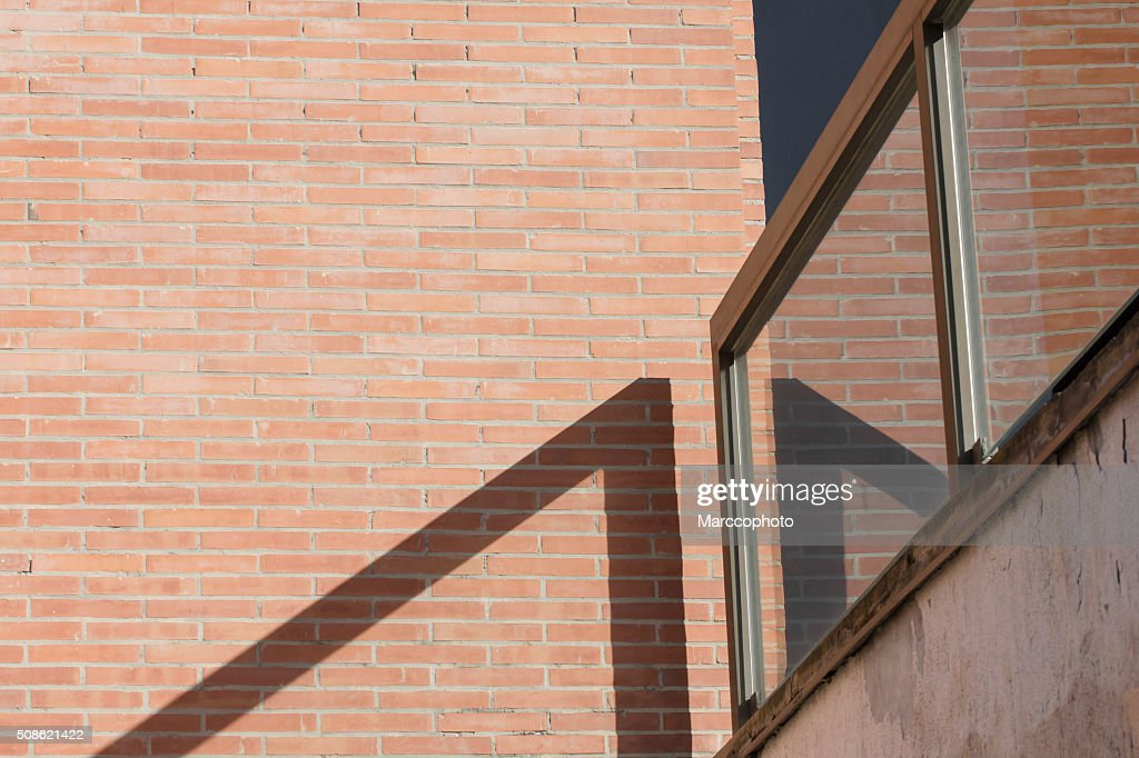 Railing and red brick wall : Stock Photo