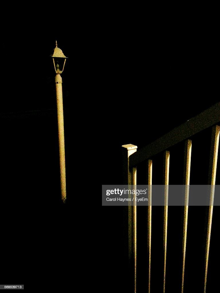 Railing By Gas Light Against Clear Sky At Night : Stock Photo