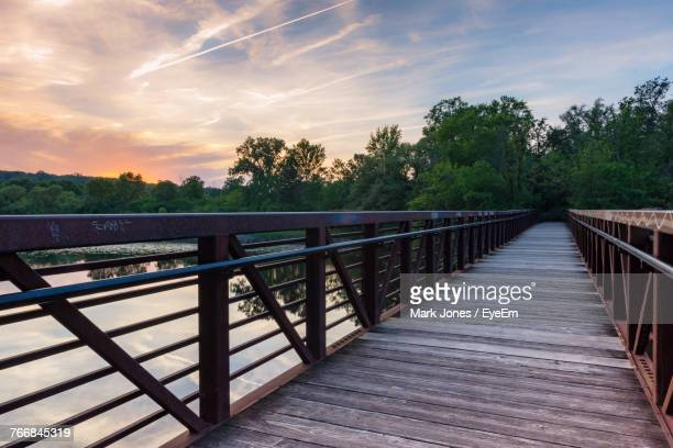 railing by trees against sky during sunset - ann arbor stock pictures, royalty-free photos & images
