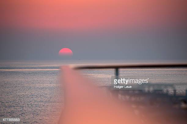 railing of cruise ship at sunset - ms deutschland cruise ship stock photos and pictures