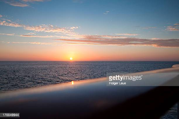 railing of cruise ship ms deutschland at sunset - ms deutschland cruise ship fotografías e imágenes de stock