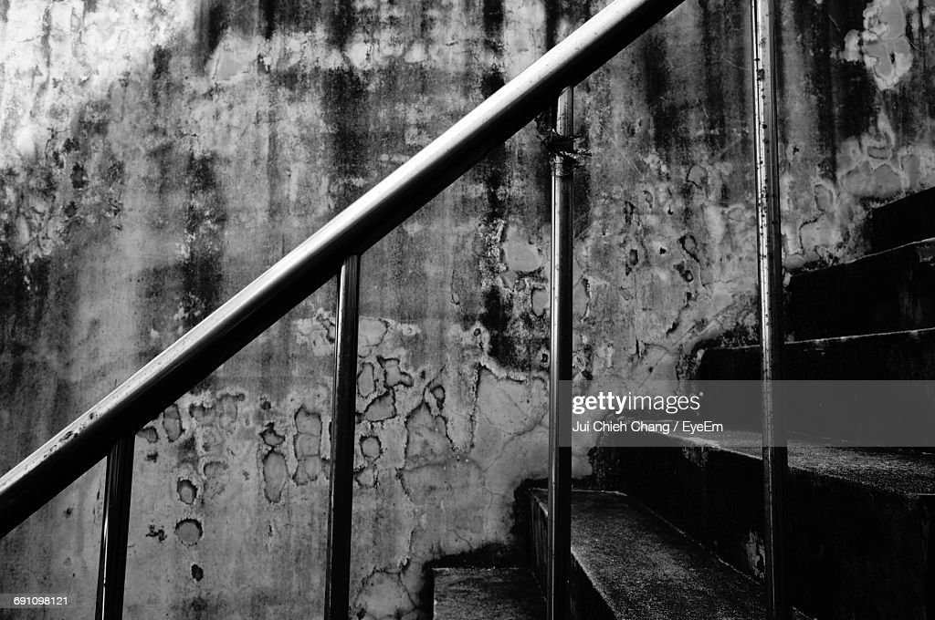 Railing On Staircase Against Wall : Stock Photo