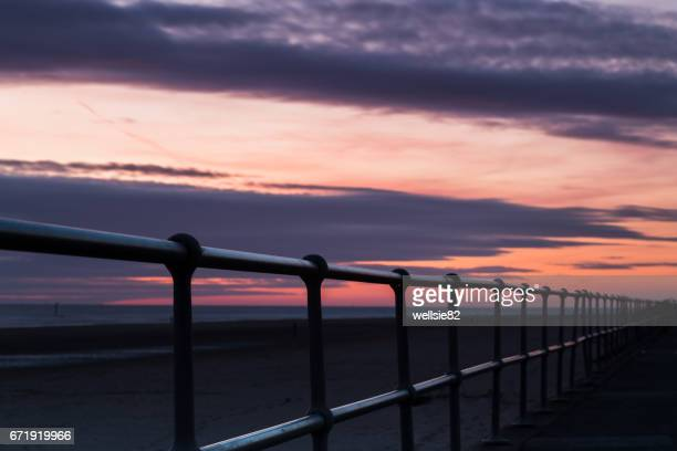 railings along crosby beach - antony gormley stock pictures, royalty-free photos & images