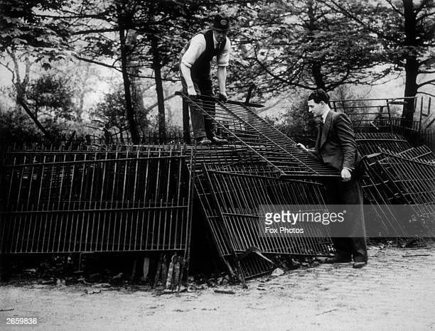Railings from Battersea Park in London being pulled up for salvage.