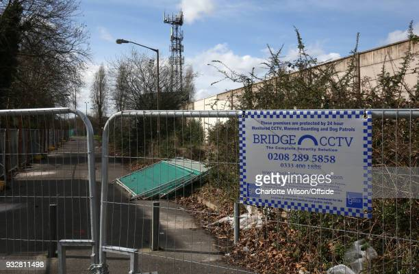 Railings have been erected outside Champion Hill to ward off fans whilst they row with the stadium owners a sign on the railings warns of CCTV...