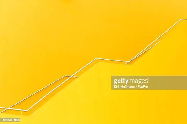 railings of yellow building - yellow photos et images de collection