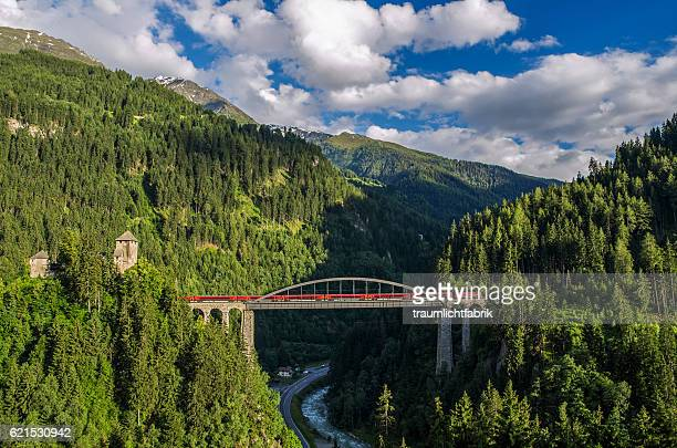 oebb railjet train passing a bridge in tyrol - central europe stock photos and pictures