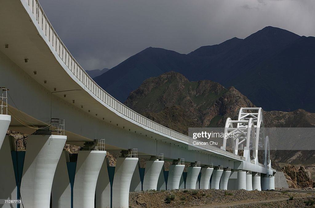 A railroad bridge of the Qinghai-Tibet Railway in the shape of Hada (or Khatag), a white scarf that Tibetan people use to express their best wishes, stands over the Lhasa River on June 24, 2006 in Lhasa, Tibetan Autonomous Region, China. The Qinghai-Tibet railway will begin trial operations on July 1 and has scheduled the first five trains to Tibet via the new railway, an official with the Qinghai-Tibet Railway Company said. The 1,956-kilometer-long (about 1,215 miles) Qinghai-Tibet railway that links Xining, the capital of Qinghai Province, with Lhasa, capital of Tibet Autonomous Region is the world's highest and longest plateau railroad and also the first railway connecting Tibet with other parts of China. Some 960 kilometers (576 miles) of its track are located 4,000 meters (13,120 feet) above sea level and the highest point is 5,072 meters (16,636 feet), according to state media.