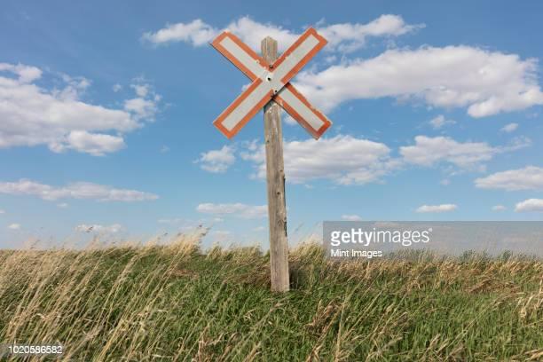 Railroad caution sign on prairie