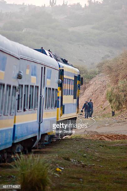 CONTENT] Railroad conductors check tracks in front of stopped Expreso Del Sur train In Bolivia the railroads are in disrepair and poorly maintained...