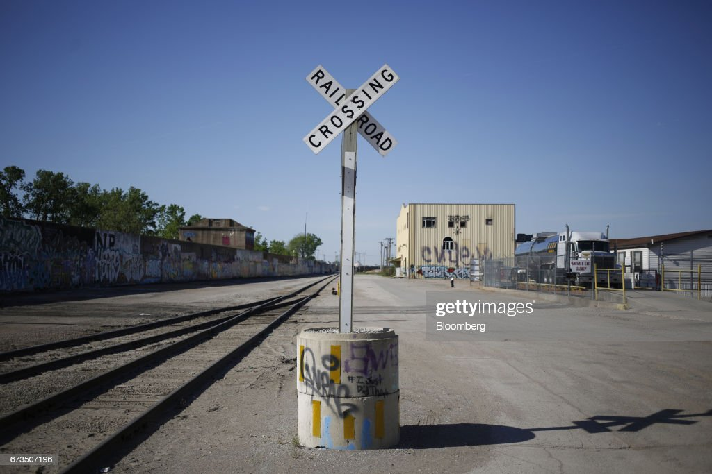 A railroad crossing crossbuck sign stands along Union