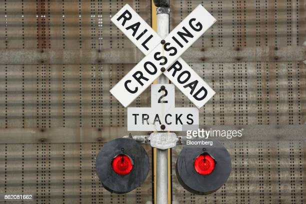 A railroad crossing gate stands along tracks owned by CSX Corp in Bowling Green Kentucky US on Thursday Oct 12 2017 CSX is scheduled to release...