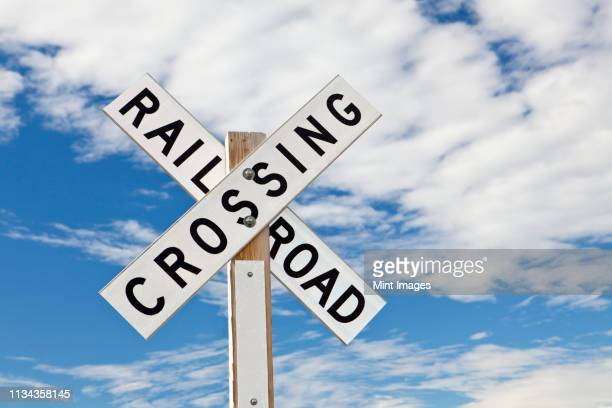 railroad crossing sign - railroad crossing stock pictures, royalty-free photos & images