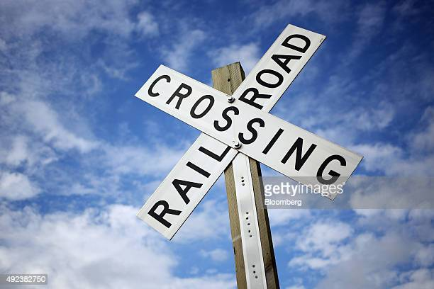 A railroad crossing sign stands along tracks owned by CSX
