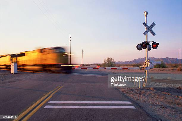 railroad crossing with train - railroad crossing stock pictures, royalty-free photos & images