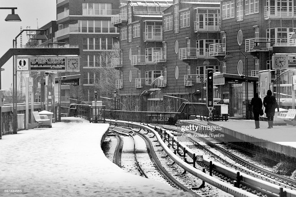 Railroad Station By Buildings During Winter : Stock Photo
