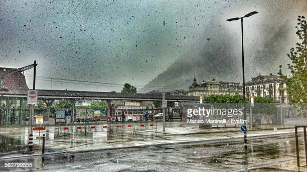 Railroad Station By Mountain Against Sky During Monsoon