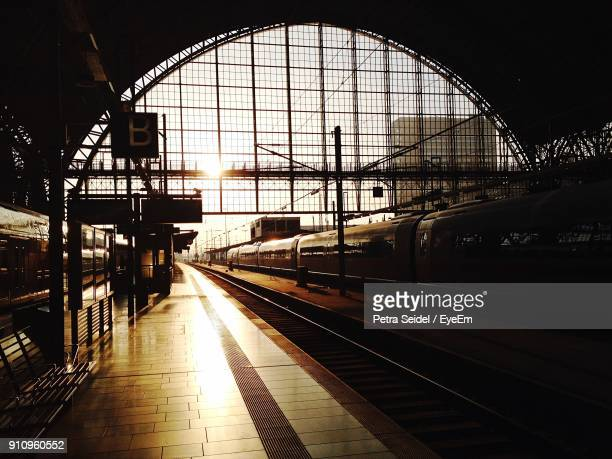 railroad station platform against sky - railway station stock pictures, royalty-free photos & images