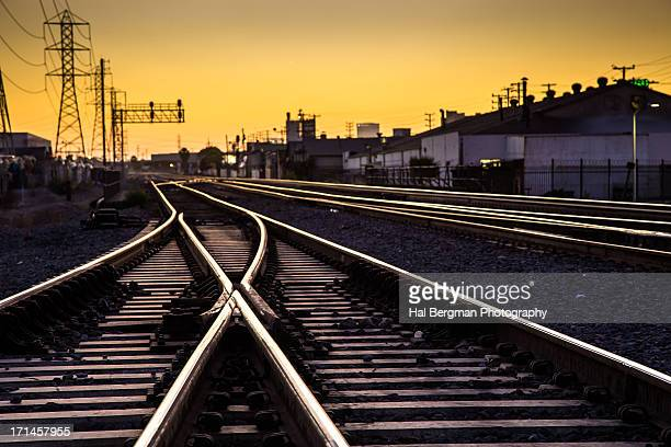 railroad switch at dusk - shunting yard stock photos and pictures