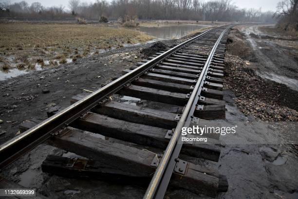 Railroad ties hang below a section of flood damaged Burlington
