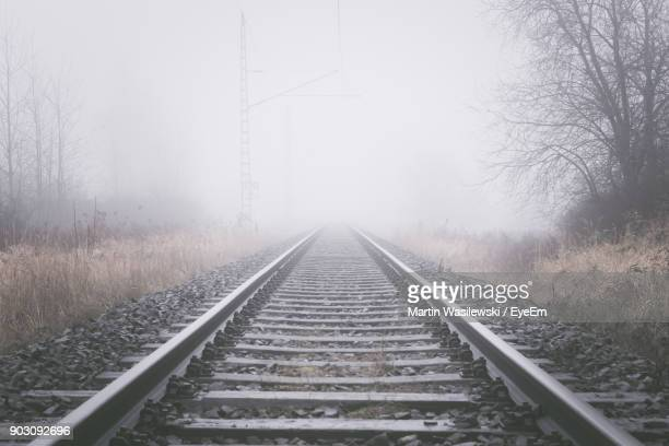 Railroad Track Against Sky During Foggy Weather