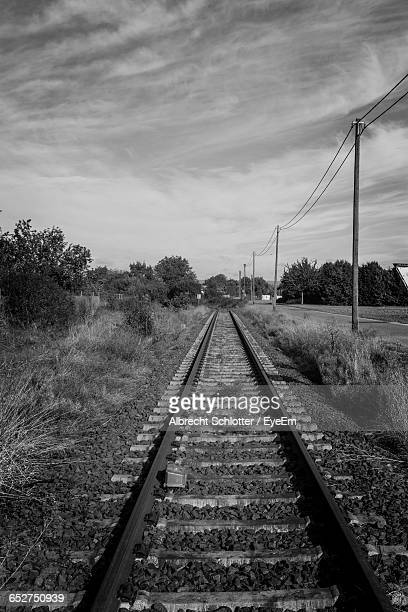 railroad track against sky - albrecht schlotter stock photos and pictures