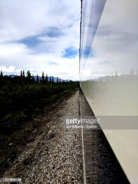 railroad track amidst field against sky - cantwell stock pictures, royalty-free photos & images