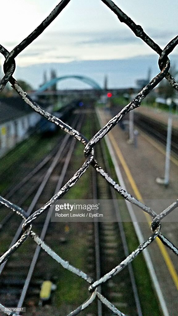 Railroad Track Behind Fence : Foto stock