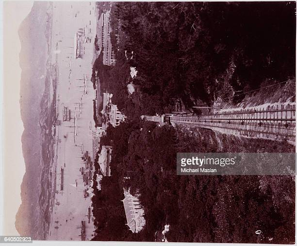 A railroad track leads toward Victoria Harbor in Hong Kong