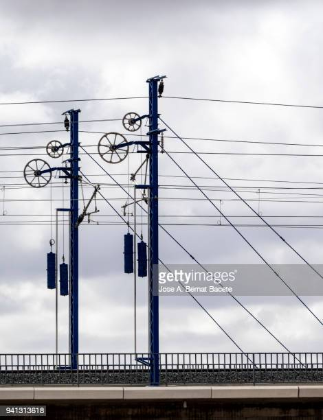 railroad track of the high-speed train on a bridge, with his electrical towers and catenary. valencia, spain - metra train stock photos and pictures