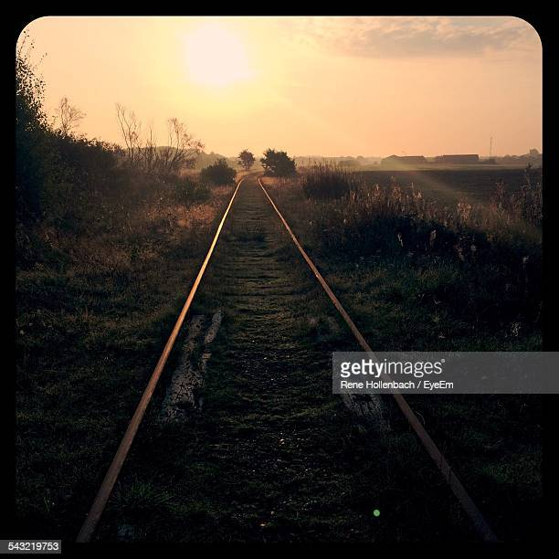 Railroad Track On Field Against Sky During Morning