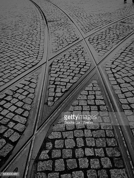 Railroad Track Passing Through Cobblestone Street