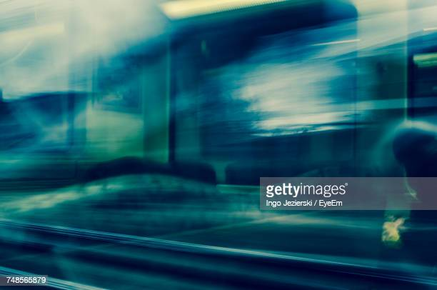 Railroad Track Seen Through Window With Reflection